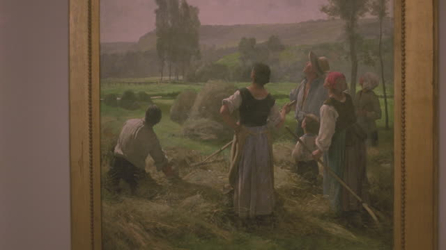 vídeos de stock e filmes b-roll de medium angle of european painting depicting pastoral scene of workers in field. see landscape of painting in background. - museu