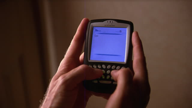 close angle of man's hands holding pda, typing a text message. - organizer stock-videos und b-roll-filmmaterial