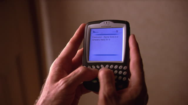 close angle of man's hands holding pda, typing a text message. - electronic organizer stock videos and b-roll footage