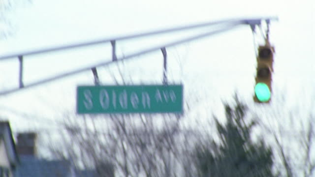 """hand held angle of a street sign that reads """"south olden ave"""". - anno 2002 video stock e b–roll"""
