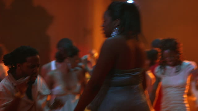 MEDIUM ANGLE OF YOUNG WOMEN, MEN DANCING IN BAR, DANCE CLUB, TAVERN OR NIGHTCLUB.  MUSIC.
