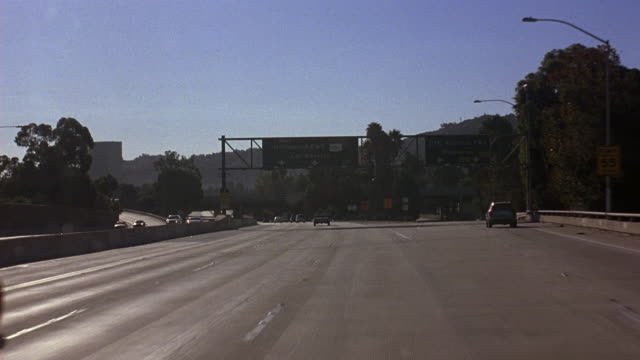 wide angle driving pov straight forward of freeway 101 south. passes ventura freeway 134 to pasadena exit. drives under highway or street signs. cars and trucks. - pasadena california stock videos & royalty-free footage