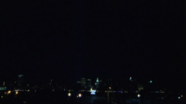 HAND HELD DRIVING POV OF THE NEW YORK CITY SKYLINE.  THE EMPIRE STATE BUILDING AND THE WORLD TRADE CENTER MEMORIAL LIGHT ART INSTALLATION.