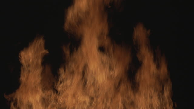 medium angle, of fire, flames against black backdrop. - visual effect stock videos & royalty-free footage