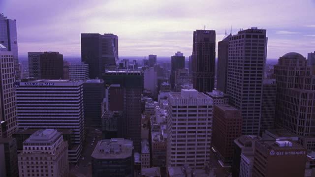 vídeos de stock, filmes e b-roll de aerial of melbourne city skyline. high rise buildings include optus centre. downtowns, office buildings. - 2007