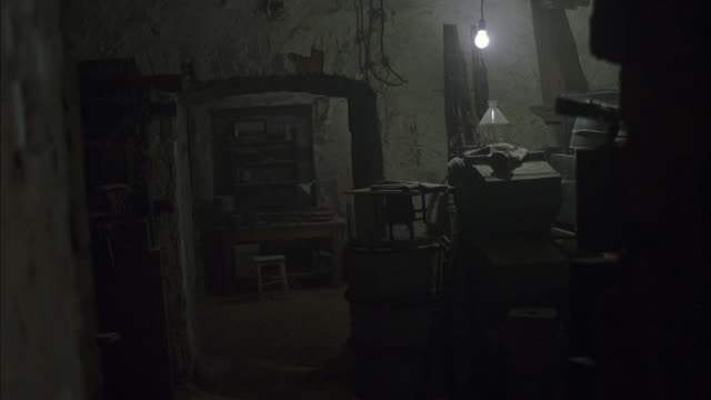 wide angle of bunker or building interior. building has old, chipped walls and exposed light bulbs. - budapest stock videos & royalty-free footage