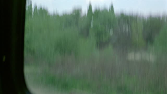 wide angle driving pov straight forward on bumpy dirt road toward lower class trailer home or mobile home. see black car and blue truck parked out front. - trailer home stock videos & royalty-free footage