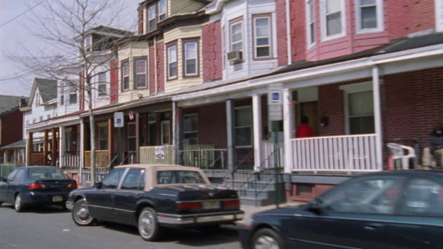 stockvideo's en b-roll-footage met wide angle straight forward driving pov of a neighborhood in a residential area of middle class two story houses. - new jersey