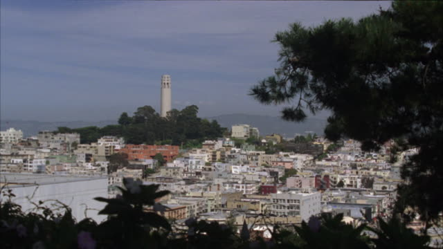 wide angle of telegraph hill and the coit tower in a residential area of the san francisco skyline. - north beach san francisco stock videos and b-roll footage
