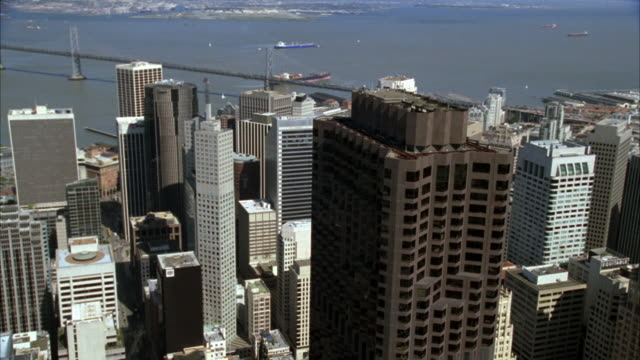 aerial of the san francisco skyline. downtown office buildings, skyscrapers.  the camera moves toward the 555 california street building, also known as the bank of america building. - bank of america stock videos and b-roll footage