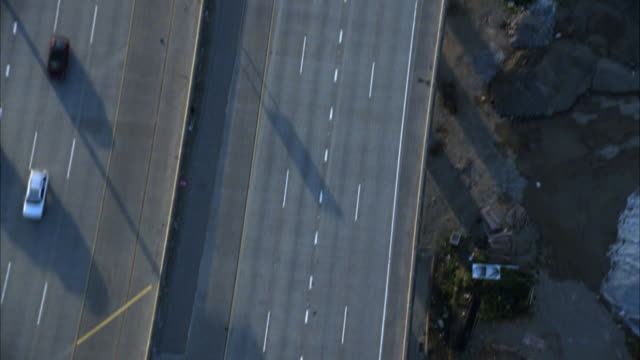 AERIAL BIRDSEYE POV OF A FREEWAY OR HIGHWAY.