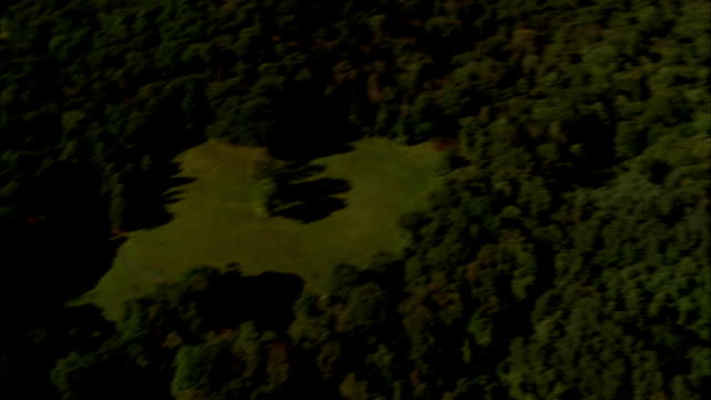 aerial of the hudson valley forest. trees and grass fields cover land. pov pans to the hudson river and the tappan zee bridge. upper state new york. - hudson valley stock videos and b-roll footage