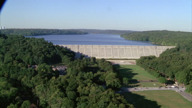 aerial of hudson valley in upper state new york. aerial pans over dam along the hudson river . - hudson valley stock videos and b-roll footage