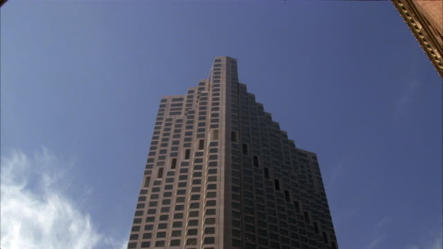 up angle of the 555 california street building in san francisco, also known as the bank of america building. an office building skyscraper in the downtown financial district in a commercial area. - bank of america stock videos and b-roll footage