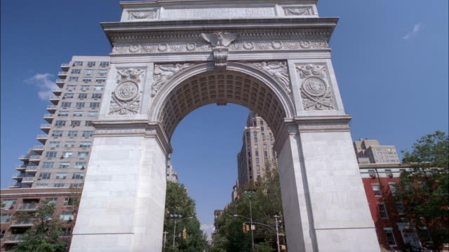 up angle medium of constantine arch, entrance to washington square park in greenwich village. see multi-story brick apartment buildings in background. - arch architectural feature stock videos and b-roll footage