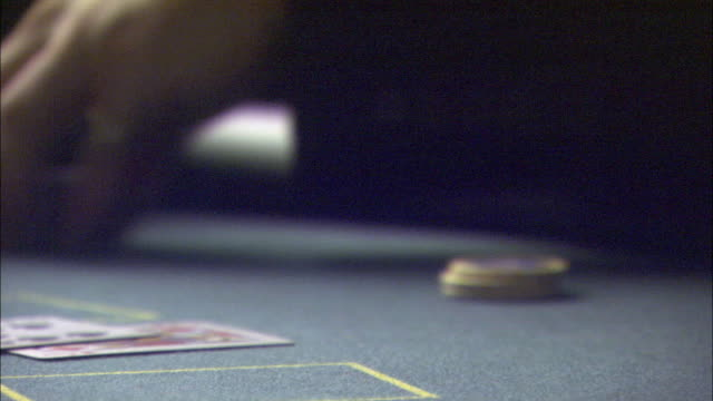 close angle time lapse of a man's hands counting chips at a blackjack table in a casino. - blackjack stock videos and b-roll footage