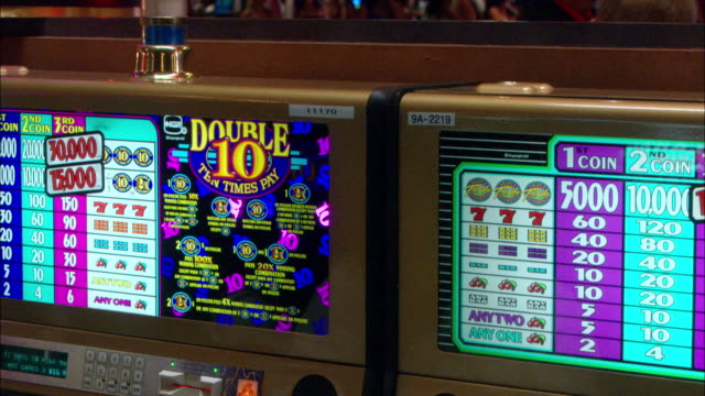 vídeos y material grabado en eventos de stock de close angle of slot machine in casino. gambling. - tragaperras