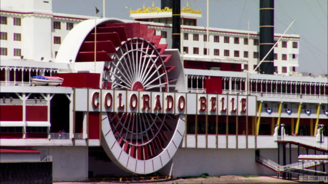 pan right to left of riverboat-themed colorado belle hotel casino. - casino floor stock videos & royalty-free footage