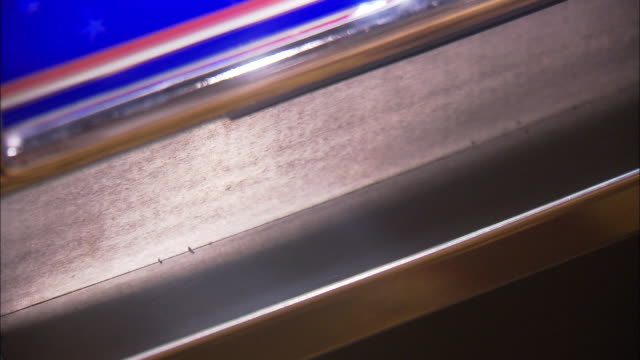 CLOSE ANGLE OF QUARTERS COMING OUT OF THE BOTTOM OF A SLOT MACHINE IN A CASINO.  SOMEONE OPENS THE MACHINE AND CLOSES IT.  GAMBLING, WINNER, WINNING.
