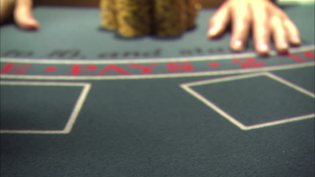 close angle of casino chips on blackjack table. series of dealer passing trays loaded with casino chips to player. could be used as winnings in a high stakes game or for player exchanging money for table money. gambling. - winnings stock videos and b-roll footage