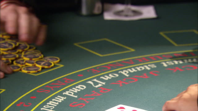 close angle of casino chips in trays passed back and forth from dealer to player. trays add to pile of chip winnings already in front of player. - winnings stock videos and b-roll footage