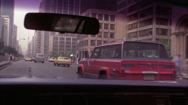 wide angle moving pov forward, from driver's seat, to the right. sedan or car driving on busy city street, park avenue southbound. midtown manhattan, east side. windshield and rear view mirror. - 1978 stock videos and b-roll footage