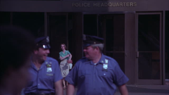 "wide angle of people entering and exiting buidling with sign ""police headquarters"".  one police plaza, nypd police headquarters. - 1978 stock videos and b-roll footage"