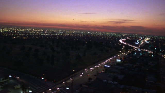 aerial of city lights, cityscape. headlights and taillights of cars, vehicles driving on freeways, highways visible. - 1982 stock videos & royalty-free footage
