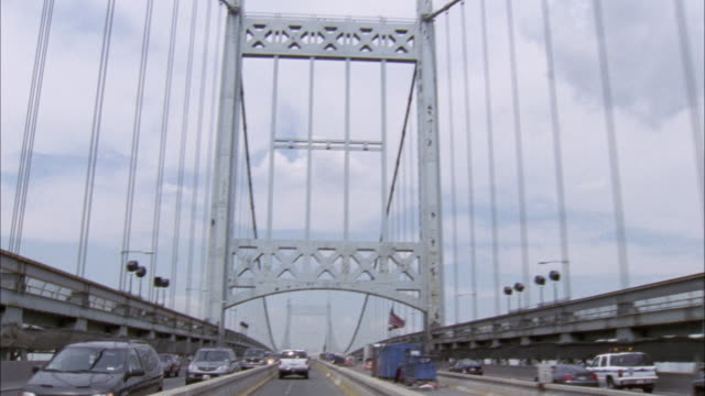 up angle. driving down triborough bridge. towards one of the suspension towers. - suspension bridge stock videos & royalty-free footage