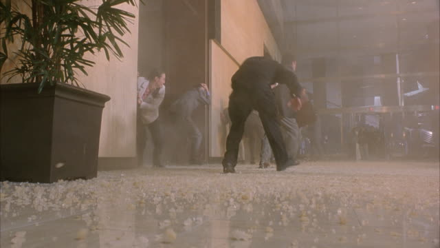 vidéos et rushes de wide angle inside lobby of office building. pov from ground looking up across lobby floor.  see people walking around lobby. explosion. people begin running and ducking for cover as debris and glass fall to the floor. explosions. - hall d'accueil