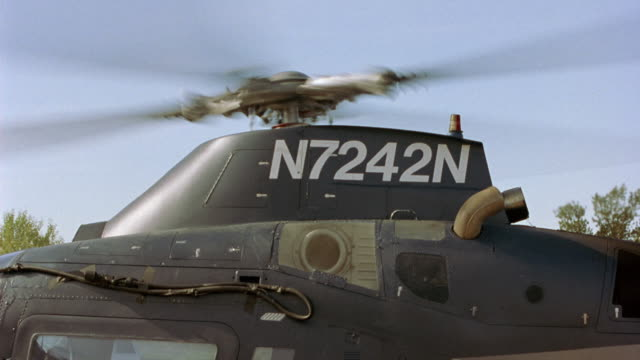 "zoom in. rotors of helicopter spinning before take-off. zooms in on model number of helicopter ""n7232n"" and zooms back out to rotors several times in shot. - helicopter rotors stock videos and b-roll footage"
