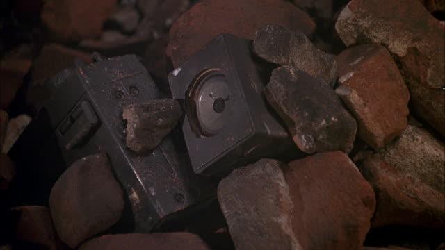close angle, smoldering brick, rubble, vibrating speaker. see smoke rise. - loudspeaker stock videos & royalty-free footage