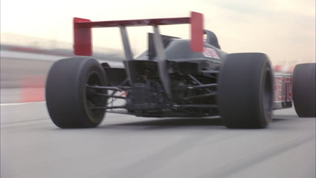 "process plate of black formula one race car with red star and red text reading ""redstar"" on side speeding down race track. - formula one racing stock videos & royalty-free footage"