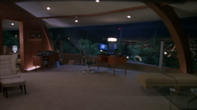 wide angle of living room of modern house in hollywood hills. floor length windows overlook los angeles cityscape. - floor length stock videos & royalty-free footage