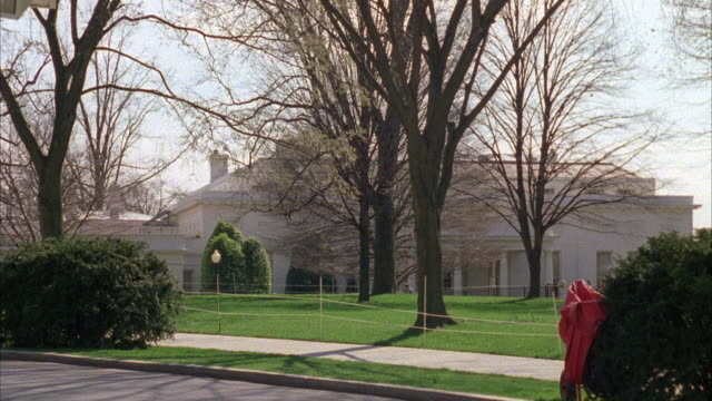wide angle on the west wing of the white house. barren trees suggest winter season. government building. - white house washington dc stock videos & royalty-free footage