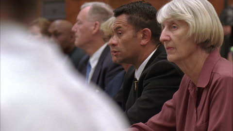 stockvideo's en b-roll-footage met hand held medium angle of government officials seated at conference table, listening.  could be medical review board, police commission, any public officials. - politiek