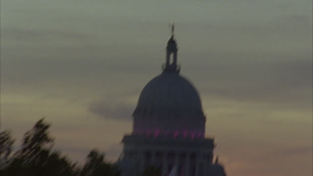 HAND HELD ANGLE FROM A SUNSET TO  THE RHODE ISLAND STATE HOUSE CAPITOL BUILDING. GOVERNMENT BUILDING, DOMED BUILDING.