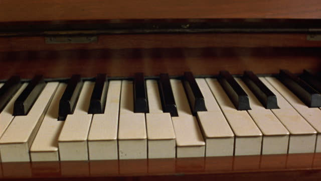 medium angle brown player piano. see keys press down and get released automatically. neg cut. - automatic stock videos & royalty-free footage