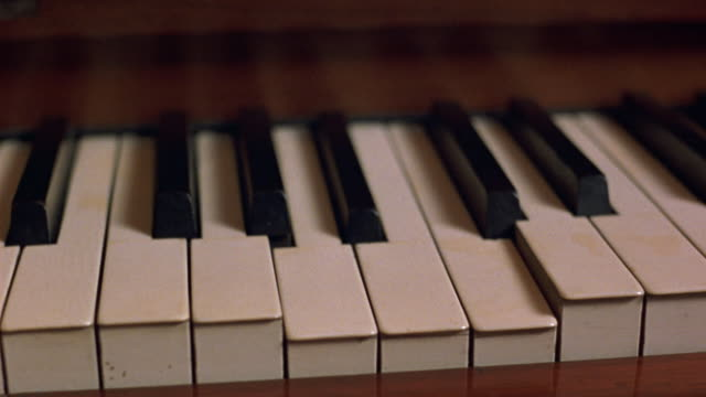 medium angle brown player piano. see keys press down and get released automatically. - piano key stock videos & royalty-free footage