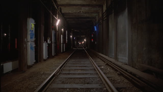 stockvideo's en b-roll-footage met process plate straight forward of subway train from inside subway tunnel. camera starts moving down track at high speed. shot on 21 mm - tunnel