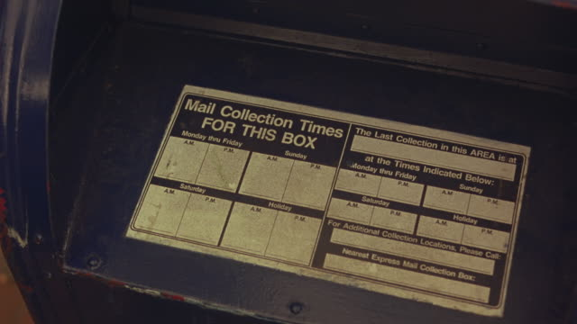 close angle of usps mailbox. see label with mail collection times. united states mail. could be outside of post office building. - postamt stock-videos und b-roll-filmmaterial