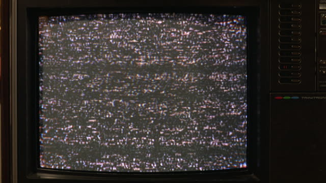 close angle of television screen with static. tv has buttons for channels, is older model. burn-ins. - television static stock videos & royalty-free footage
