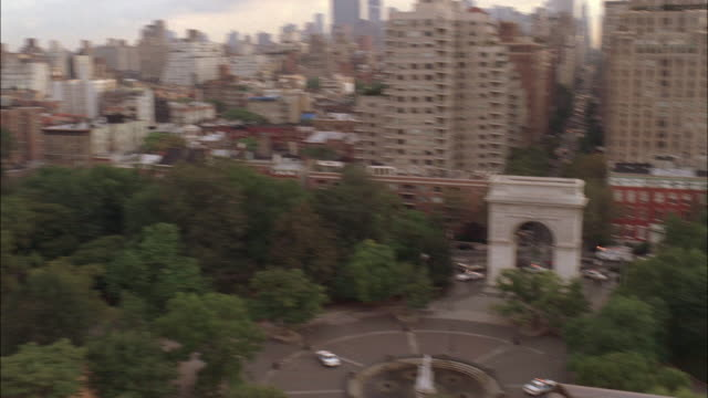 high angle down of washington square park. see multi-story brick buildings, possibly apartment buildings or office buildings. - washington square park stock videos and b-roll footage