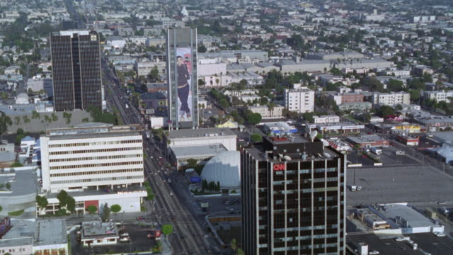 aerial of sunset boulevard near vine st. cnn office building, arclight hollywood cinerama dome. movie theater. high rise office buildings with billboards. advertisements - arclight cinemas hollywood video stock e b–roll