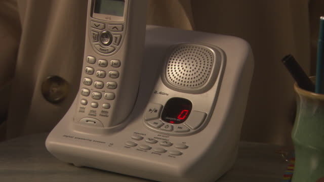 close angle of cordless telephone speaker. see number buttons and led display. could be phone in office, house, home office, or restaurant. - cordless phone stock videos and b-roll footage