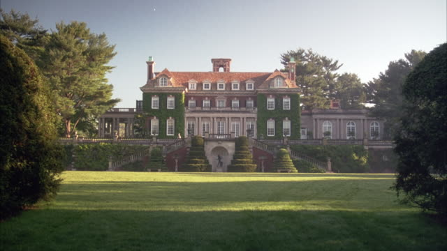 wide angle establish of mansion at old westbury gardens. georgian-style, multi-story house with twin staircases leading up on either side. - old westbury stock videos and b-roll footage