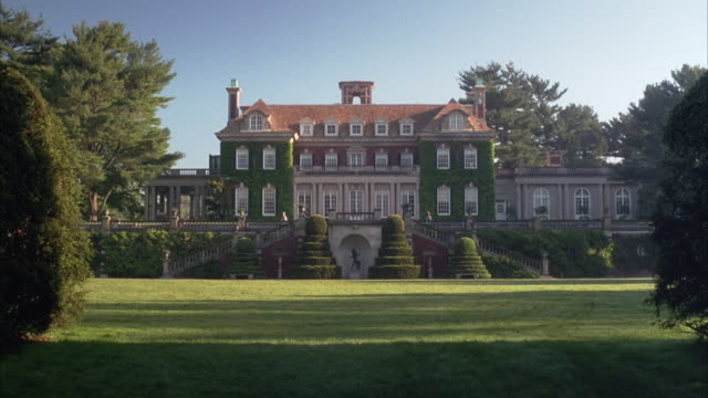 wide angle establish of old westbury gardens. georgian-style, multi-story mansion with twin staircases leading up on either side. - old westbury stock videos and b-roll footage