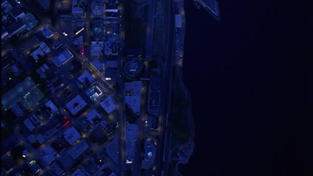 aerial birdseye pov of multi-story buildings at puget sound waterfront. - norra stilla havet bildbanksvideor och videomaterial från bakom kulisserna