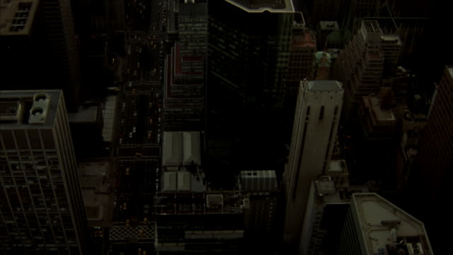 aerial over high rise buildings in midtown manhattan. pan up to show lower manhattan in background including world trade center twin towers. - general electric building stock videos and b-roll footage