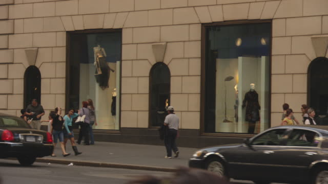 pan left to right of bergdorf goodman storefront on fifth avenue in manhattan. see shoppers and pedestrians on sidewalk in front of store. - bergdorf goodman stock videos and b-roll footage